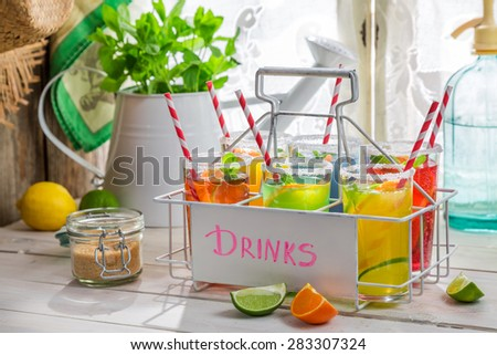 Cold drink with citrus and mint leaf - stock photo