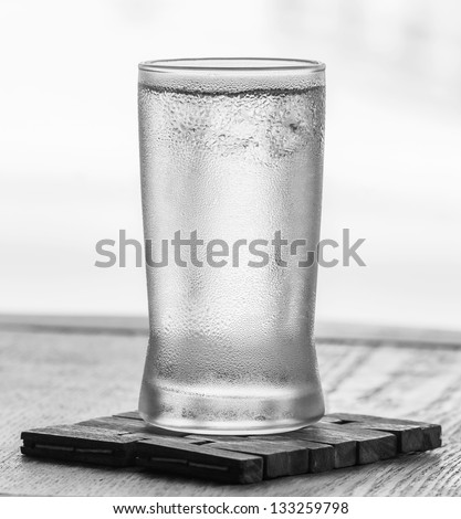 Cold drinking water in glass with water droplet - stock photo