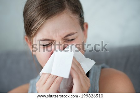 Cold flu illness of child - tissue blowing runny nose - stock photo