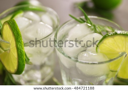 Cold fresh cocktails with lime, closeup