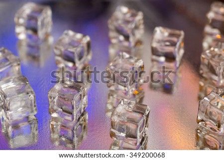 Cold fresh ice cubes on wet glass - stock photo