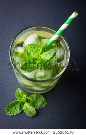 Cold fresh lemonade with mint and ice, top view - stock photo
