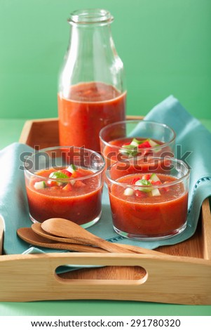 cold gazpacho soup in glass and ingredients - stock photo