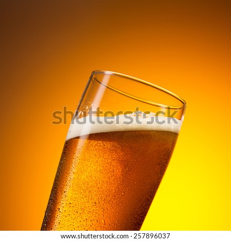 cold german beer in a glas with drops of condensation