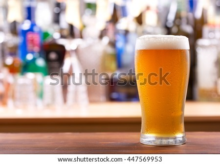 cold glass of beer in a bar