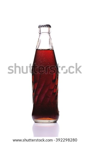 cold glass of Coke bottle - stock photo