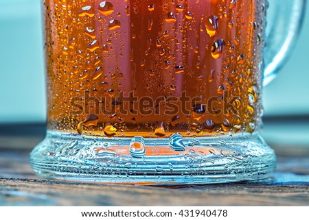 Cold glass of iced tea on wooden table top.  - stock photo