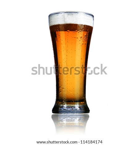 Cold glass of light beer isolated on a white background. - stock photo