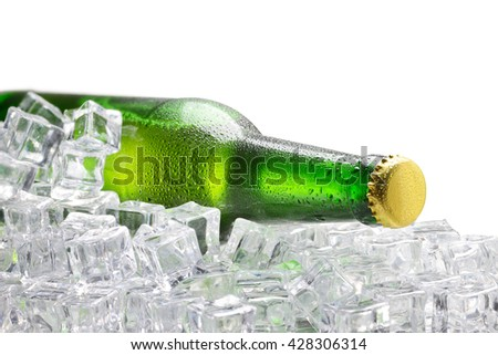 Cold green bottle of beer with water droplets and ice cubes on white background - stock photo