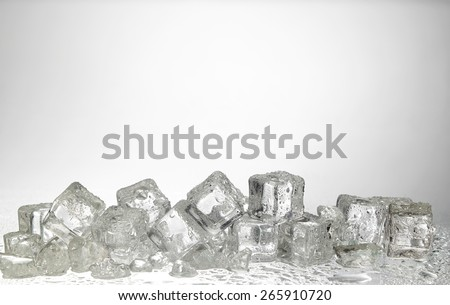cold ice cubes on the white background - stock photo