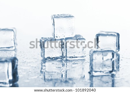 Cold ice cubes with water drops