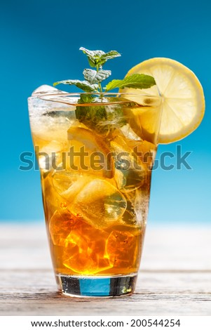 Cold ice tea on blue background