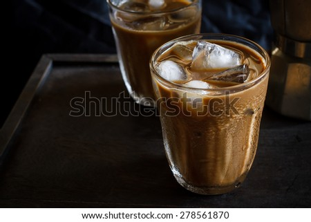 Cold Iced Coffee put on old wooden - stock photo