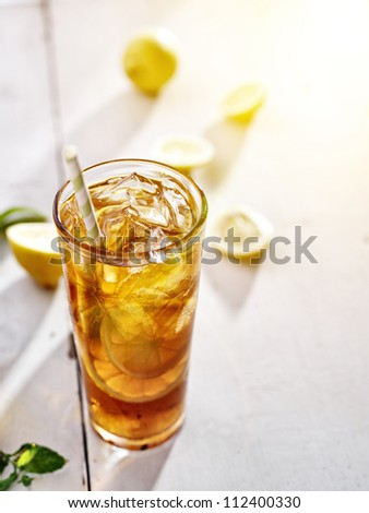 cold iced tea with lemons and copy space composition. - stock photo