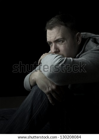 cold, man sitting on floor in depression or feeling cold with copy space - stock photo