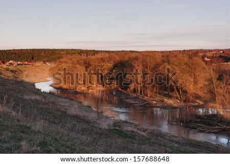 Cold morning landscape with a river.s
