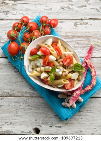 cold pasta salad with slice tomatoes mozzarella and beans