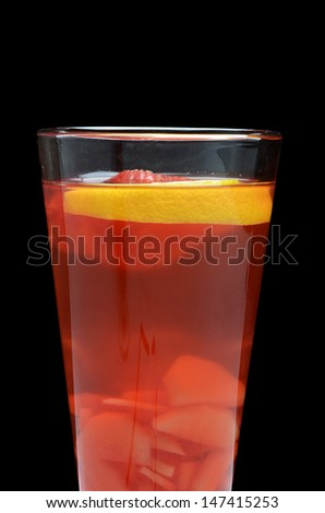 Cold red fruit tea with an orange