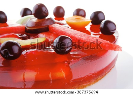 cold red jelly cake with cherry and watermelon - stock photo