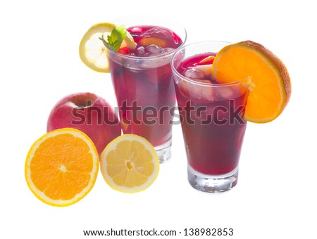 cold sangria in tall glasses with fruits isolated on white background