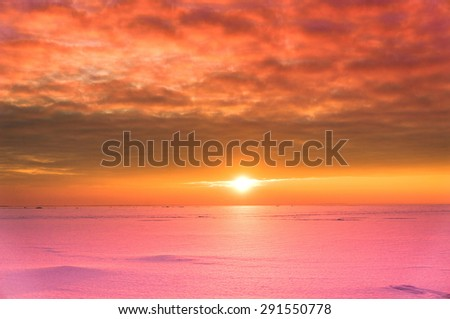 Cold Skies Sunset in the Arctic  - stock photo