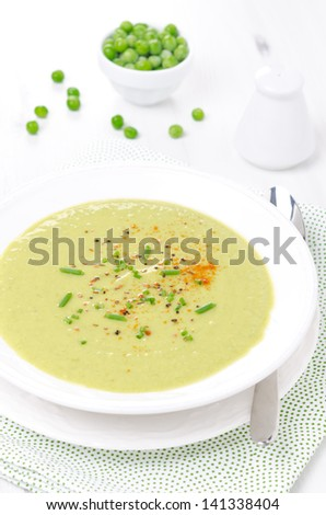 cold soup of green peas with yogurt, chives onions and peppers, vertical