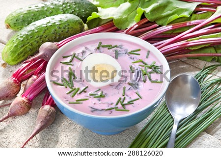 Cold soup with beetroot soup and sour milk with chives, cucumber and egg, served cold on hot days - stock photo