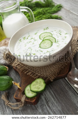 Cold soup with cucumbers, yogurt and fresh herbs on the table