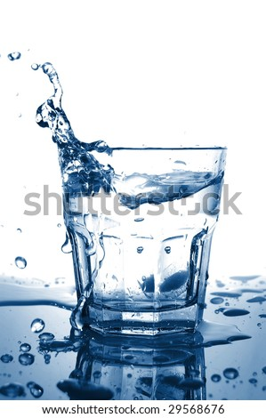 cold splashing water drink with ice cube