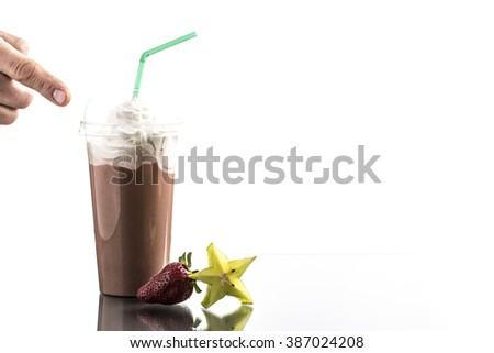 Cold summer coffee drink with drinking straw and reflection - stock photo