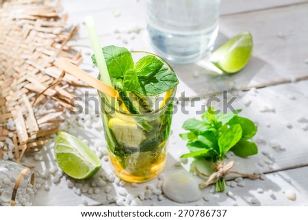 Cold summer drink with lemon and lime