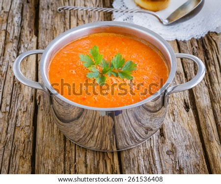 Cold summer vegetable soup a wooden background - stock photo