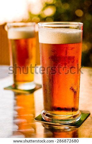 Cold tap beer served in glass - stock photo