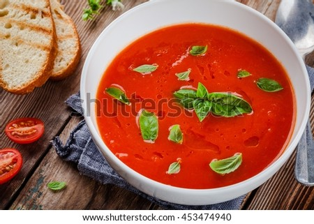 cold tomato soup gazpacho with basil and croutons - stock photo