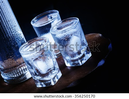 Cold vodka in a sweaty glass, toned image, selective focus - stock photo