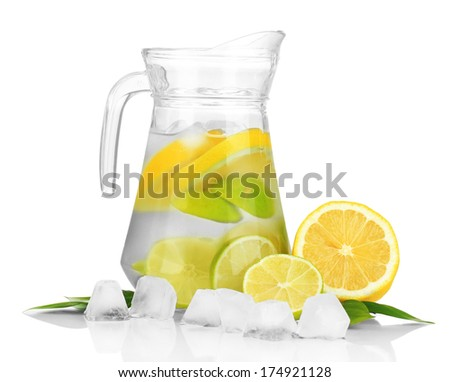Cold water with lime, lemon and ice in pitcher isolated on white - stock photo