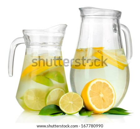 Cold water with lime, lemon and ice in pitchers isolated on white - stock photo