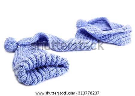 Cold winter clothing - hat or cap, scarf.