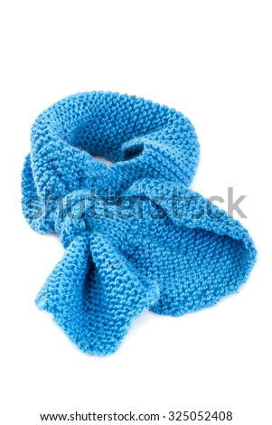 Cold winter clothing - knitted wool scarf. - stock photo