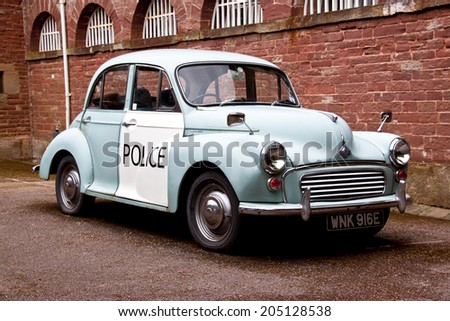 COLEFORD, GLOUCESTERSHIRE, UK - JULY 15th 2014 - old style english police car - stock photo