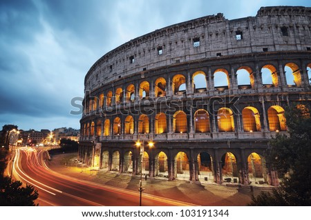 Coliseum at night with colorful blurred traffic lights. Rome - Italy. - stock photo