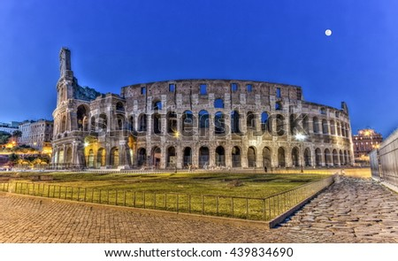Coliseum behind rocks by night, Roma, Italy - stock photo