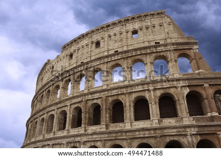 Coliseum fragment over beautiful cloudy sky, Rome, Italy