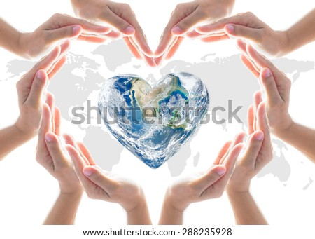 Collaborative human hands grouped in heart shape form around heart planet with world map  background: International cooperative and environment concept: Elements of this image furnished by NASA  - stock photo