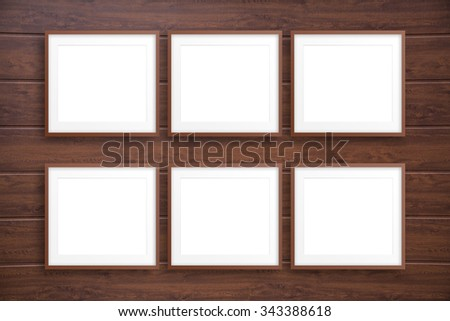 Collage frames on wooden wall - stock photo