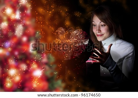 Collage of a young woman reading a magic book - stock photo