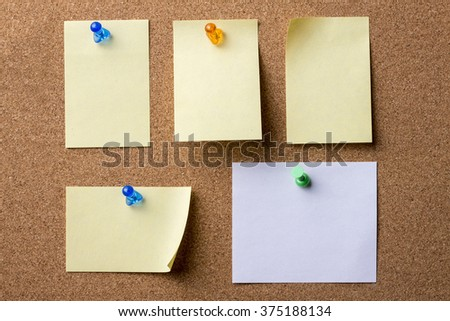 Collage of blank adhesive labels pinned on bulletin board - horizontal image