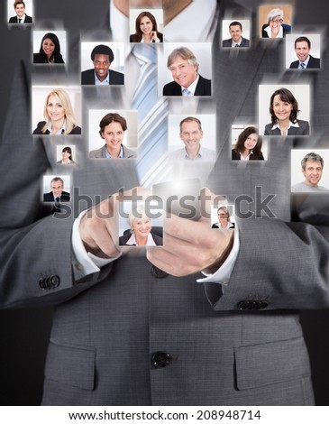 Collage of business people with businessman using cell phone representing global communication - stock photo