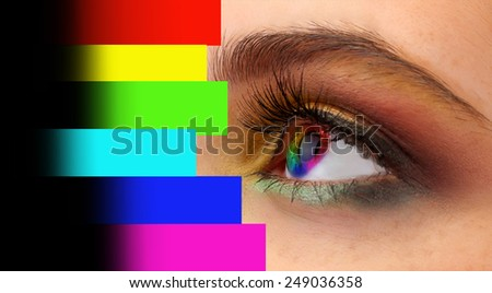 Collage of eye with color palette - stock photo