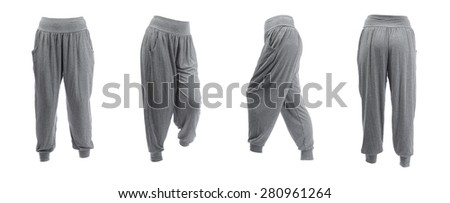 Collage of four gray sweat pants in different poses. Studio, isolate on white. - stock photo